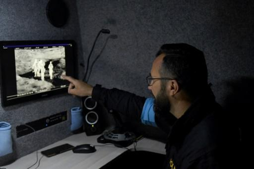 A Czech member of Frontex monitors the Albania-Greece border from inside a thermo-vision van that can detect bodies