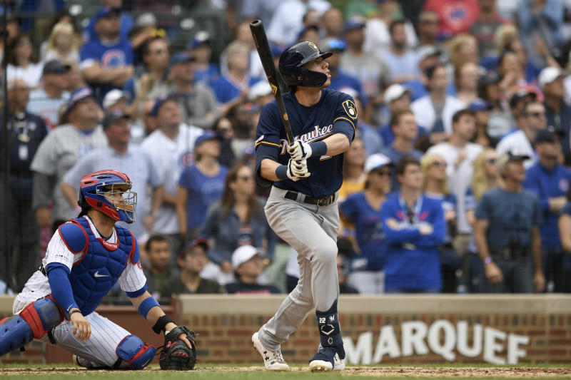 Milwaukee Brewers' Christian Yelich watches his three-run home run during the ninth inning of a baseball game against the Chicago Cubs Sunday, Sept. 1, 2019, in Chicago. (AP Photo/Paul Beaty)