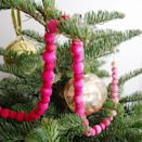 """<p>Make beaded garland in whatever color you like with an ombre effect. It looks amazing draped on stair greenery, the mantel, or the tree.</p><p><strong>See more at <a href=""""https://bestfriendsforfrosting.com/ombre-garland/"""" rel=""""nofollow noopener"""" target=""""_blank"""" data-ylk=""""slk:Best Friends for Frosting"""" class=""""link rapid-noclick-resp"""">Best Friends for Frosting</a>.</strong></p><p><a class=""""link rapid-noclick-resp"""" href=""""https://www.amazon.com/Apple-Barrel-Acrylic-PROMOABI-Assorted/dp/B00ATJSD8I/ref=sr_1_8?dchild=1&keywords=craft+paint&qid=1633172038&sr=8-8&tag=syn-yahoo-20&ascsubtag=%5Bartid%7C2164.g.37723896%5Bsrc%7Cyahoo-us"""" rel=""""nofollow noopener"""" target=""""_blank"""" data-ylk=""""slk:SHOP CRAFT PAINT"""">SHOP CRAFT PAINT</a></p>"""