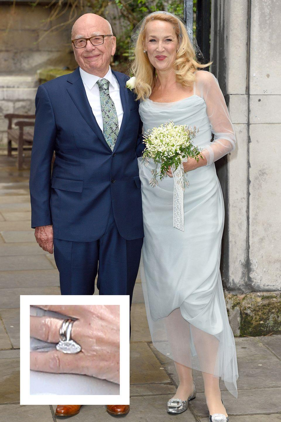 """<p>Hall and media tycoon Rupert Murdoch announced their engagement in January 2016. Hall's enormous ring is a marquise-shaped diamond on a platinum band, <a href=""""http://www.instyle.com/news/jerry-hall-engagement-ring-rupert-murdoch-photo"""" rel=""""nofollow noopener"""" target=""""_blank"""" data-ylk=""""slk:InStyle reports"""" class=""""link rapid-noclick-resp""""><em>InStyle </em>reports</a>. The center stone is <a href=""""http://www.dailymail.co.uk/femail/article-3477041/Rupert-s-lucky-man-Newlywed-Jerry-Hall-59-flashes-HUGE-engagement-ring-models-striking-magazine-spread-shot-Chanel-designer-Karl-Lagerfeld.html"""" rel=""""nofollow noopener"""" target=""""_blank"""" data-ylk=""""slk:estimated to be"""" class=""""link rapid-noclick-resp"""">estimated to be</a> a whopping 20 carats.</p>"""