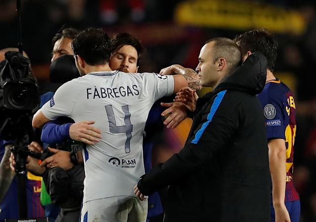 Soccer Football - Champions League Round of 16 Second Leg - FC Barcelona vs Chelsea - Camp Nou, Barcelona, Spain - March 14, 2018 Chelsea's Cesc Fabregas and Barcelona's Lionel Messi hug after the match Action Images via Reuters/Lee Smith