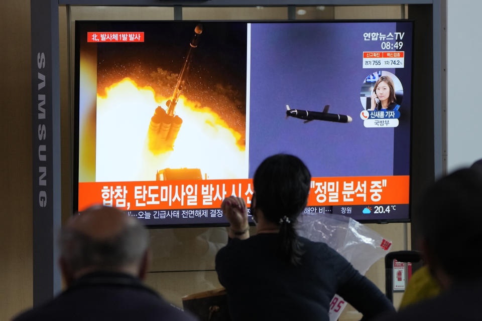 """People watch a TV showing a file image of North Korea's missiles launch during a news program at the Seoul Railway Station in Seoul, South Korea, Tuesday, Sept. 28, 2021. North Korea on Tuesday fired a suspected ballistic missile into the sea, Seoul and Tokyo officials said, the latest in a series of weapons tests by Pyongyang that raised questions about the sincerity of its recent offer for talks with South Korea. The Korean letters read: """"Ballistic missile."""" (AP Photo/Ahn Young-joon)"""