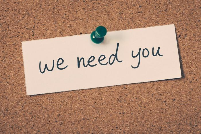 A note says we need you.