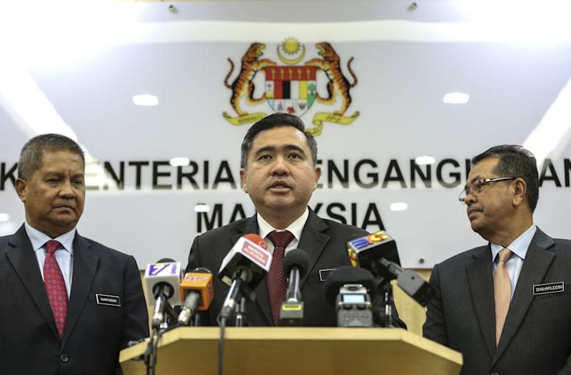 Anthony Loke (centre) speaks during a press conference at the Ministry Of Transport in Putrajaya September 19, 2018. — Picture by Azneal Ishak