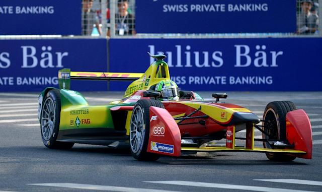 Audi Sport Abt Formula E Team driver Lucas di Grassi of Brazil takes a turn during the Formula E race at the circuit near the Bird's Nest stadium in Beijing on September 13, 2014. AFP PHOTO / WANG ZHAO (AFP Photo/WANG ZHAO)