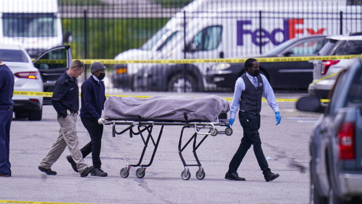 A body is taken from the scene where multiple people were shot at a FedEx Ground facility in Indianapolis, Friday, April 16, 2021. (Michael Conroy/AP Photo)