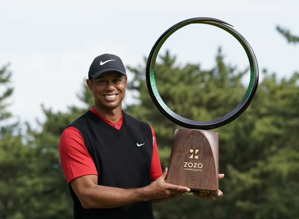 Tiger Woods of the United States poses with his trophy after winning the Zozo Championship PGA Tour at the Accordia Golf Narashino country club in Inzai, east of Tokyo, Japan, Monday, Oct. 28, 2019. (AP Photo/Lee Jin-man)
