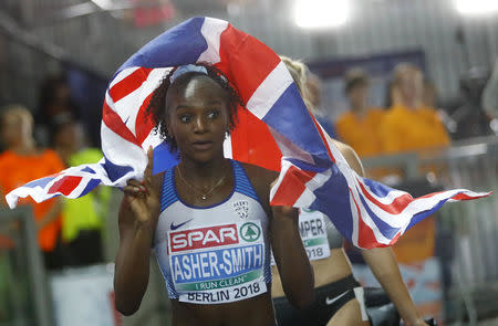 2018 European Championships - Women's 100 meters, Final - Olympic Stadium, Berlin, Germany - August 7, 2018 - Dina Asher-Smith of Britain celebrates after winning a gold medal. REUTERS/Kai Pfaffenbach