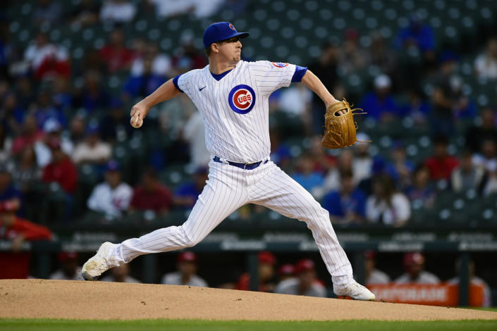 Chicago Cubs starter Alec Mills winds up during the first inning of the team's baseball game against the Cincinnati Reds on Wednesday, Sept. 8, 2021, in Chicago. (AP Photo/Paul Beaty)