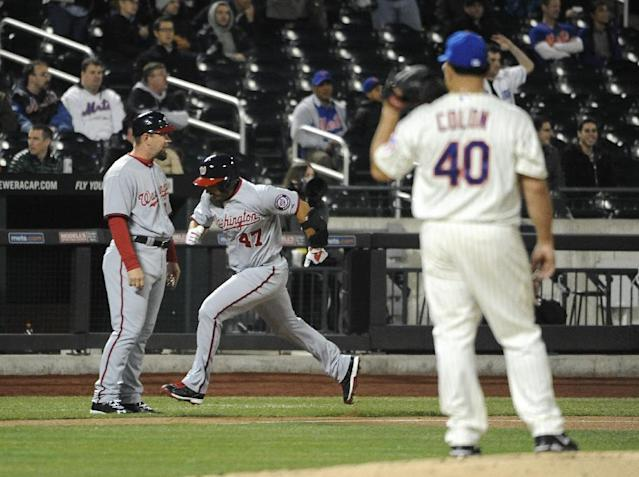 New York Mets starting pitcher Bartolo Colon (40) watches Washington Nationals' Gio Gonzalez (47) round third base past third base coach Bob Henlet after Gonzalez hit a solo home run in the fifth inning of a baseball game at Citi Field on Wednesday, April 2, 2014, in New York. (AP Photo/Kathy Kmonicek)