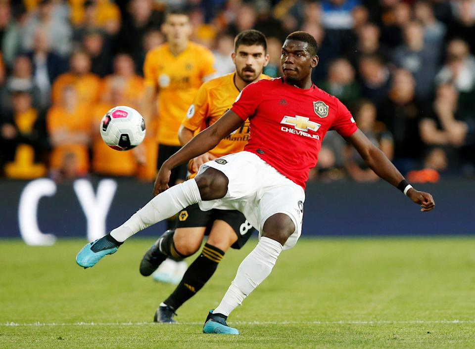 """Soccer Football - Premier League - Wolverhampton Wanderers v Manchester United - Molineux Stadium, Wolverhampton, Britain - August 19, 2019   Manchester United's Paul Pogba in action   REUTERS/Andrew Yates    EDITORIAL USE ONLY. No use with unauthorized audio, video, data, fixture lists, club/league logos or """"live"""" services. Online in-match use limited to 75 images, no video emulation. No use in betting, games or single club/league/player publications.  Please contact your account representative for further details."""