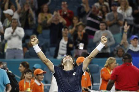 Mar 23, 2019; Miami Gardens, FL, USA; David Ferrer of Spain celebrates after his match against Alexander Zverev of Germany (not pictured) in the second round of the Miami Open at Miami Open Tennis Complex. Mandatory Credit: Geoff Burke-USA TODAY Sports