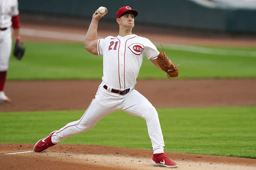 Cincinnati Reds' Michael Lorenzen pitches in the first inning of the team's baseball game against the against the Pittsburgh Pirates in Cincinnati, Tuesday, Sept. 15, 2020. (AP Photo/Bryan Woolston)
