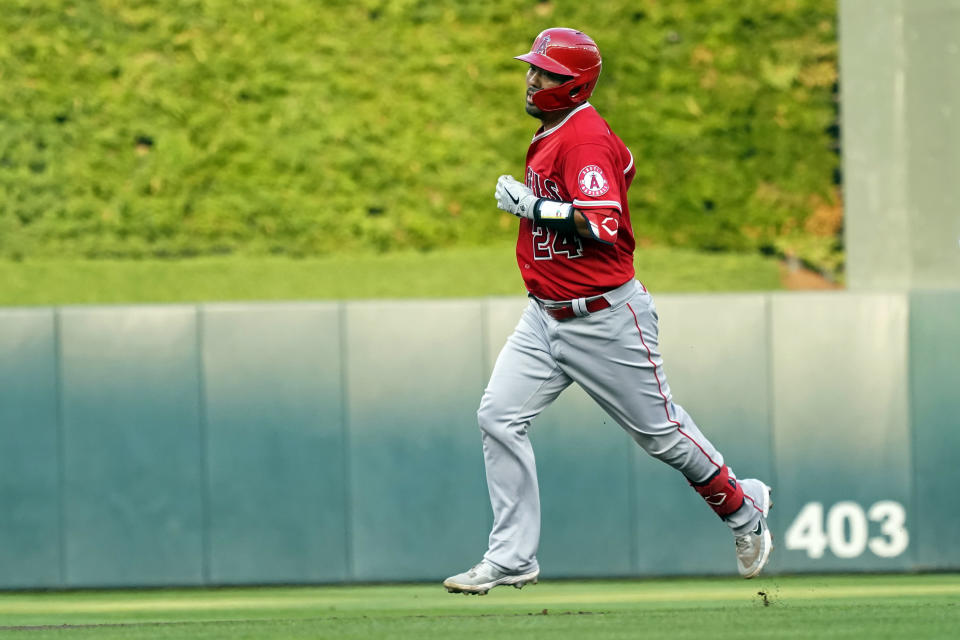 Los Angeles Angels' Kurt Suzuki runs the bases on a two-run home run off Minnesota Twins pitcher J.A. Happ during the first inning of a baseball game Friday, July 23, 2021, in Minneapolis. (AP Photo/Jim Mone)