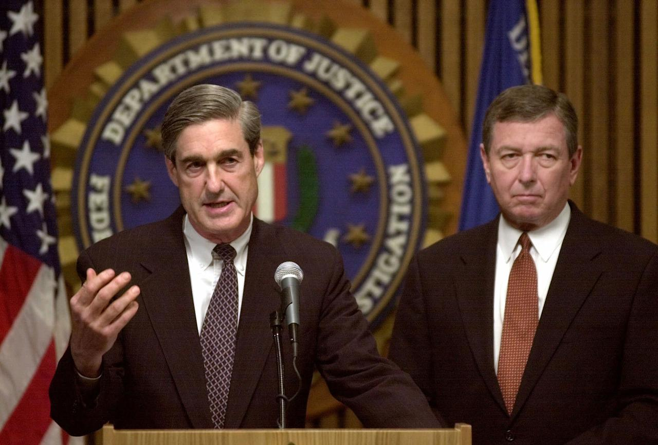 <p>FBI Director Robert Mueller, left, accompanied by Attorney General John Ashcroft, meet with reporters at FBI headquarters in Washington, Thursday, Sept. 13, 2001, to discuss the investigation of the terrorist attacks. (Photo: Susan Walsh/AP) </p>