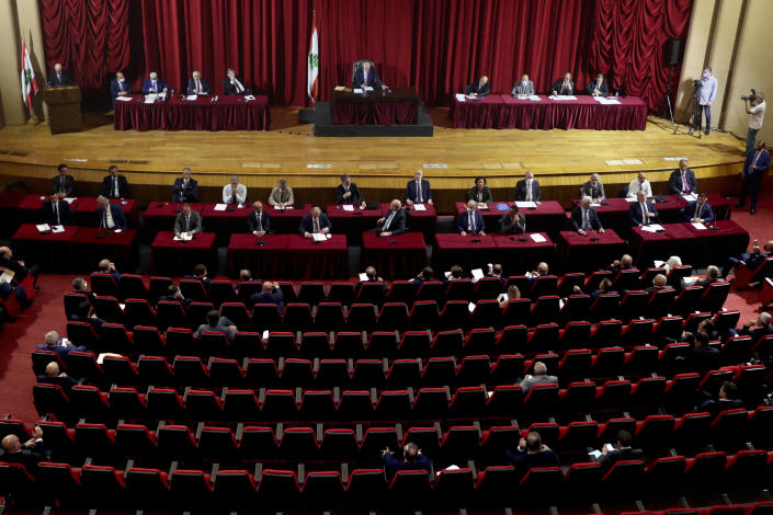 Parliament meets to confirm Lebanon's new government at a Beirut theater known as the UNESCO palace so that parliament members could observe social distancing measures imposed over the coronavirus pandemic, Lebanon, Monday, Sept. 20, 2021. A power outage and a broken generator briefly delayed the start of the parliament session for some 40 minutes before electricity came back on. (AP Photo/Bilal Hussein)