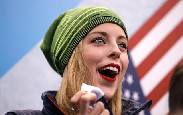SOCHI, RUSSIA - FEBRUARY 08: Figure skater Ashley Wagner of the United States cheers on teammates Marissa Castelli and Simon Shnapir as they compete in the Figure Skating Team Pairs Free Skating during day one of the Sochi 2014 Winter Olympics at Iceberg Skating Palace on February 8, 2014 in Sochi, Russia. (Photo by Pool Pool/Getty Images)