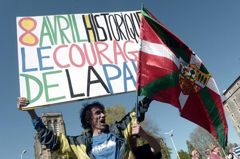 "Jean-Baptiste Redde or "" Voltuan"", a well-known protester in France for his placards, holds a sign reading: ""Historic April 8, the courage of peace"" at a rally in Bayonne"