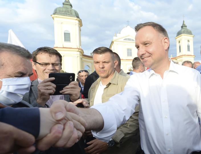 In this Wednesday, July 8, 2020 photo Poland's incumbent president Andrzej Duda, who is seeking reelection in a tight presidential election runoff on Sunday, July 12, 2020 attends a rally in Tykocin, Poland. Duda, who has backing from Poland's ruling right-wing party, is running against liberal Warsaw mayor, Rafal Trzaskowski. Opinion polls suggest the election may be decided by a small number of votes. (AP Photo/Czarek Sokolowski)
