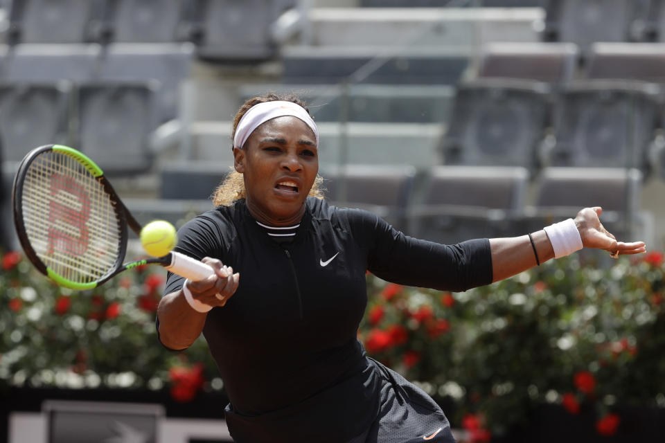 Serena Williams, of the United States, returns the ball to Sweden's Rebecca Peterson during their match at the Italian Open tennis tournament, in Rome, Monday, May, 13, 2019. (AP Photo/Gregorio Borgia)