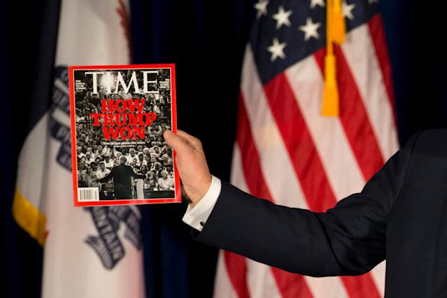 <p>Presumptive Republican presidential candidate Donald Trump holds his Time cover during a rally, Jan. 12, 2016, in Cedar Falls, Iowa. <i>(Photo: Jae C. Hong/AP)</i> </p>