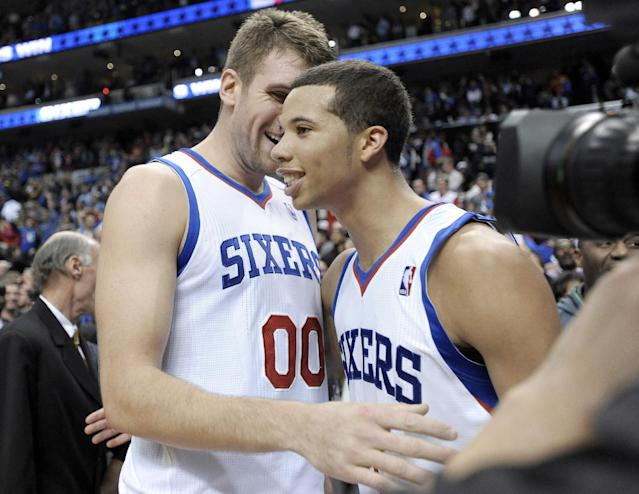 Philadelphia 76ers' Spencer Hawes (00) celebrates with Michael Carter-Williams after their 114-110 win over the Miami Heat in an NBA basketball game, Wednesday, Oct. 30, 2013, in Philadelphia. (AP Photo/Michael Perez)