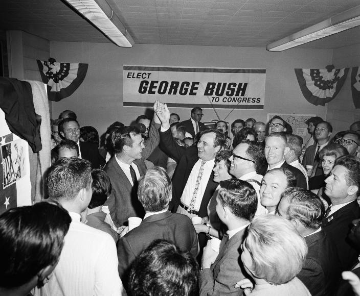 <p>Republican George Bush (left) raises his hand in victory next to newly elected Democrat Bob Eckhardt of the 8th Congressional District of Harris County. Bush, winner of the newly created 7th Congressional District of Harris County, beat Democrat Frank Briscoe, and Eckhardt defeated W.D. Spayne of the Constitutional Party. The victory celebration took place in Bush's campaign headquarters on Nov. 9, 1966. (Photo: Ed Kolenovsky/AP) </p>