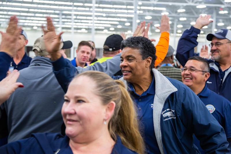 Drivers give high-fives at a Walmart hiring event in Casa Grande, Arizona.