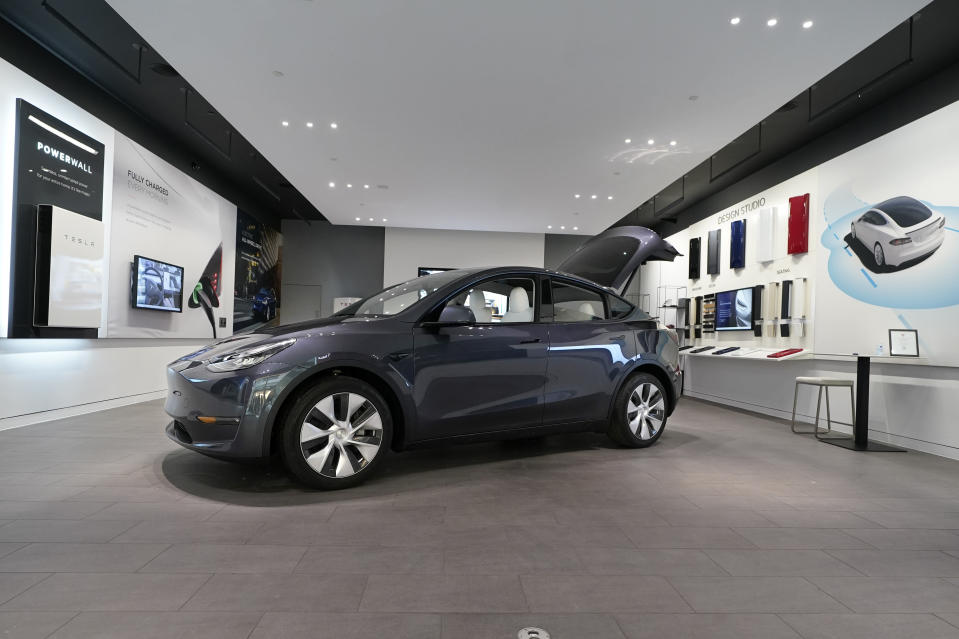 A Tesla Model Y Long Range is displayed on Feb. 24, 2021, at the Tesla Gallery in Troy, Mich. Opinion polls show that most Americans would consider an EV if it cost less, if more charging stations existed and if a wider variety of models were available. The models are coming, but they may roll out ahead of consumer tastes. And that could spell problems for the U.S. auto industry, which is sinking billions into the new technology with dozens of new vehicles on the way. (AP Photo/Carlos Osorio)