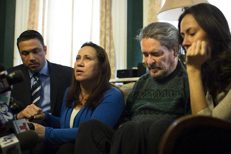 Betzaida Jimenez, mother of 33-year-old Sarai Sierra who was found dead on Saturday in Turkey, speaks to the media at a friend's home in Staten Island alongside Congressman Michael Grimm, left, her husband Dennis Jimenez, and family friend Magdalena Rodriguez, Monday, Feb. 4, 2013, in New York. The New York City woman went missing while vacationing alone in Istanbul on Jan. 21, the day she was due to board her flight back home. (AP Photo/John Minchillo)