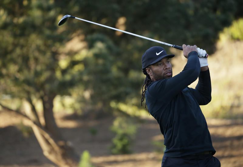 Larry Fitzgerald gets a hole in one, with President Obama as witness