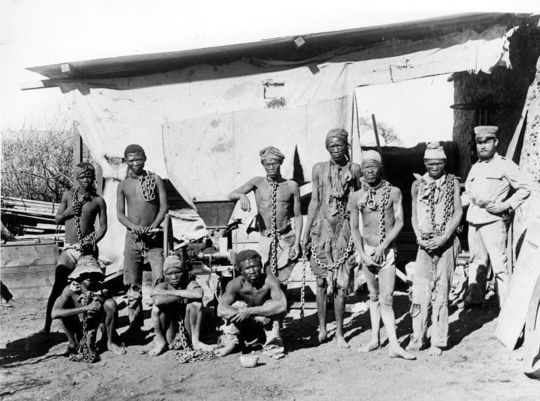 At least 60,000 Herero and around 10,000 Nama were killed between 1904 and 1908. In this photo, a soldier probably belonging to the German troops supervises Namibian war prisoners