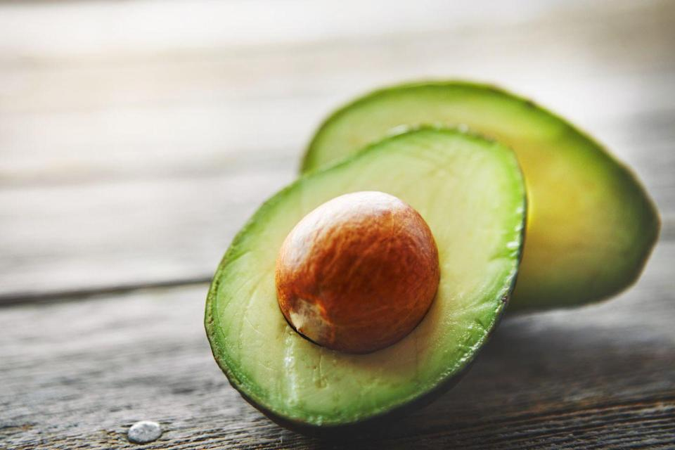 """<p>These smooth, buttery fruits are a great source of not only MUFAs but other key nutrients as well. """"Avocados are packed with heart-protective compounds, such as soluble fiber, vitamin E, folate, and potassium,"""" says Elizabeth Somer, RD, author of <em><a href=""""https://www.amazon.com/Habits-That-Mess-Womans-Diet-ebook/dp/B002KCFID0/ref=sr_1_fkmrnull_1?tag=syn-yahoo-20&ascsubtag=%5Bartid%7C2140.g.35066477%5Bsrc%7Cyahoo-us"""" rel=""""nofollow noopener"""" target=""""_blank"""" data-ylk=""""slk:10 Habits That Mess Up a Woman's Diet"""" class=""""link rapid-noclick-resp"""">10 Habits That Mess Up a Woman's Diet</a></em>. But since they're calorie-dense, be sure to watch your portion sizes. Use avocado in place of another high-fat food or condiment, such as cheese or mayo. </p><p><strong>Try it: </strong><a href=""""https://www.prevention.com/food-nutrition/recipes/a26986386/salmon-avocado-tomato-salad-recipe/"""" rel=""""nofollow noopener"""" target=""""_blank"""" data-ylk=""""slk:Salmon Salad with Avocado and Sweet Grape Tomatoes"""" class=""""link rapid-noclick-resp"""">Salmon Salad with Avocado and Sweet Grape Tomatoes </a></p>"""