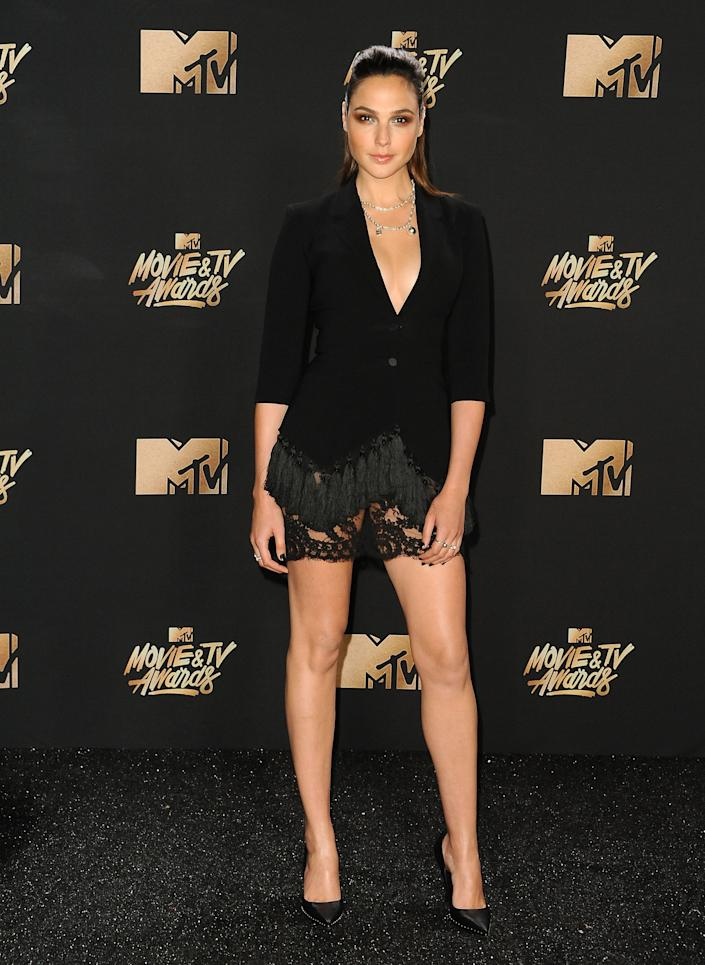 Actress Gal Gadot poses in the press room at the 2017 MTV Movie and TV Awards at The Shrine Auditorium on May 7, 2017 in Los Angeles, California.