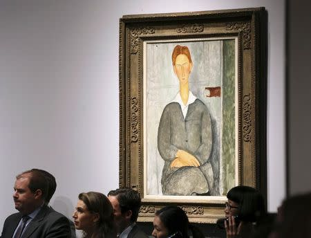 """The artwork titled """"Jeune homme roux assis"""" by artist Amedeo Modigliani is seen during a Christie's auction in New York May 6, 2014. REUTERS/Adam Hunger"""