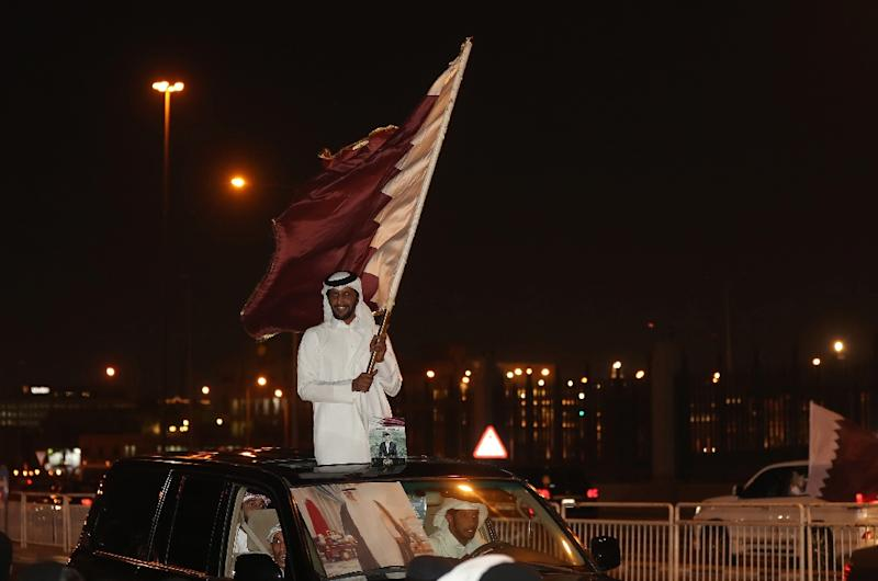 Qataris take to the streets of Doha to welcome back the Emir upon his return from his first trip abroad during the ongoing Gulf diplomatic crisis on September 24, 2017