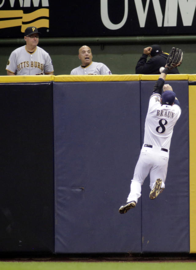 Milwaukee Brewers right fielder Ryan Braun (8) cannot catch a two-run RBI double hit by Pittsburgh Pirates' Josh Harrison during the second inning of a baseball game Friday, Aug. 22, 2014, in Milwaukee. (AP Photo/Darren Hauck)