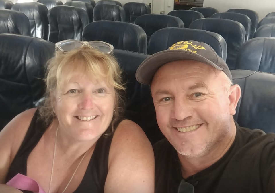 A photo of Colin Ahearn, with wife Tracy, during their trip to Thailand sat on an empty plane. While en route to Phuket, Mr Ahearn discovered his personal details printed on a receipt he was about to throw out.