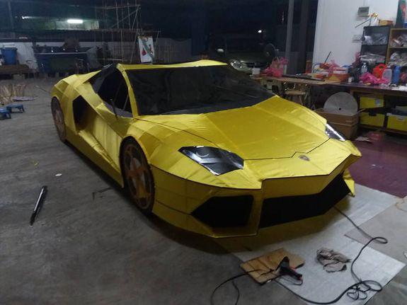 """<img alt=""""""""/><p>Talk about bling in the afterlife.</p> <p>Behold this 1:1 paper model of a golden Lamborghini that is going viral.</p> <div><p>SEE ALSO: <a rel=""""nofollow"""" href=""""http://mashable.com/2017/01/25/chinese-new-year-food-mashup/?utm_campaign=Mash-BD-Synd-Yahoo-Watercooler-Full&utm_cid=Mash-BD-Synd-Yahoo-Watercooler-Full"""">These Chinese festive food mashups are blowing our minds</a></p></div> <div></div> <p>The Lamborghini — made by 26-year-old Lin Zhao Wei — was created for Qing Ming, a three-day Chinese festival where people burn paper offerings to their ancestors, believed to receive the gifts in the afterlife.</p> <p>Lin made the Lamborghini with the help of a friend, who helped with the computer design work. Both of them took a month to complete the paper supercar, <a rel=""""nofollow"""" href=""""http://www.sinchew.com.my/node/1623478/%E8%B1%AA%E6%B0%94%E6%B8%85%E6%98%8E%E7%A5%AD%E5%93%81%E2%80%A716%E4%B8%87%E7%BA%B8%E6%89%8E%E8%93%9D%E5%AE%9D%E5%9D%9A%E5%B0%BC"""">according to the <em>Sin Chew Daily</em></a>.</p> <p><img></p> <div><p>Image:  LIM ZHAO WEI/FACEBOOK</p></div><p><img></p> <div><p>Image:  Lim Zhao Wei/Facebook</p></div><p>The car was set ablaze in a Penang cemetery.</p> <p>The car is hardly the first luxury item to be made for the festival. Common offerings include paper <a rel=""""nofollow"""" href=""""http://www.usatoday.com/story/news/world/2015/04/04/china-tomb-sweep-festival-burning-iphones/25292229/"""">iPhones</a>, and mini replicas of mansions — but it's not often you see such a large item recreated.</p> <p>Lin reportedly works out of his house and only accepts preorders. He's previously made a Porsche and a vintage car.</p> <p>""""I also received orders for superbikes, yachts, aeroplanes and bicycles,"""" Lin said.</p> <div> <h2><a rel=""""nofollow"""" href=""""http://mashable.com/2016/11/17/eco-friendly-foldable-bike-helmet/?utm_campaign=Mash-BD-Synd-Yahoo-Watercooler-Full&utm_cid=Mash-BD-Synd-Yahoo-Watercooler-Full"""">WATCH: This cheap, folding helmet is exactly what bi"""