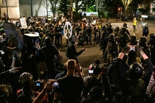 Demonstrators confront law enforcement during a protest against racial injustice, police brutality and the deployment of federal troops to US cities on July 29, 2020 in Portland, Oregon