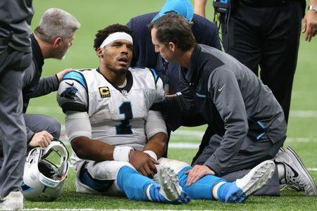 Jan 7, 2018; New Orleans, LA, USA; Carolina Panthers quarterback Cam Newton (1) is examined after being tackled by the New Orleans Saints during the fourth quarter in the NFC Wild Card playoff football game at Mercedes-Benz Superdome. Mandatory Credit: Chuck Cook-USA TODAY Sports
