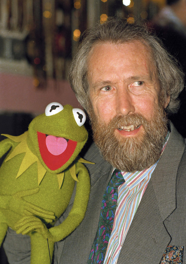 """FILE - In this Feb. 1988 file photo, Jim Henson, creator of the Muppets, poses with Kermit the Frog. This first episode of """"Sesame Street"""" aired in the fall of 1969. (AP Photo/File)"""