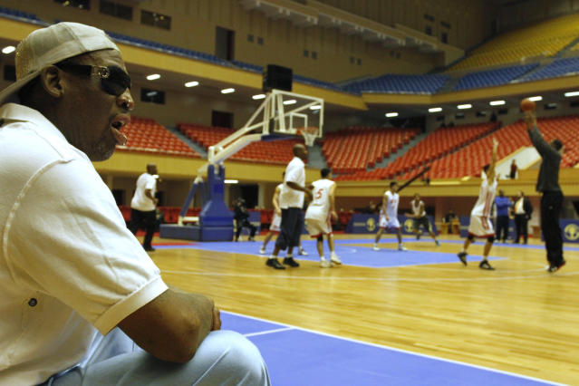 Dennis Rodman watches court side as North Korean and U.S. basketball players practice in Pyongyang, North Korea on Tuesday, Jan. 7, 2014. Rodman came to the North Korean capital with a squad of U.S. basketball stars for an exhibition game on Jan. 8, the birthday of North Korean leader Kim Jong Un. (AP Photo/Kim Kwang Hyon)
