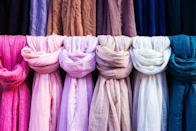 Instead of tossing all your scarves into a pile, put some shower curtain rings to good use. By hooking them to some easily-installable towel bars inside your closet, you'll have the perfect place to organize the pretty accessories without them getting wrinkly or tangled.