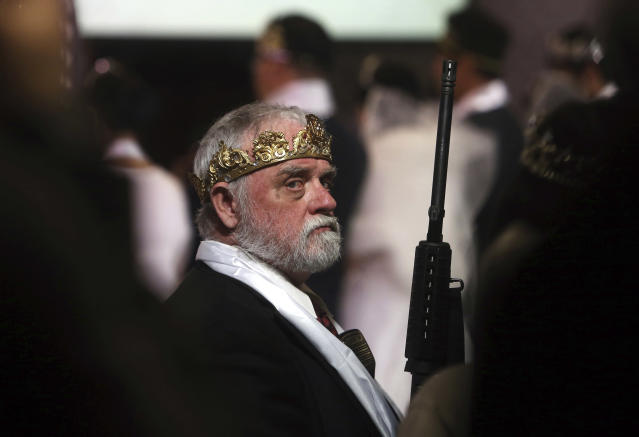 <p>A man wears a crown and holds an unloaded weapon at the World Peace and Unification Sanctuary, Wednesday, Feb. 28, 2018, in Newfoundland, Pa. (Photo: Jacqueline Larma/AP) </p>