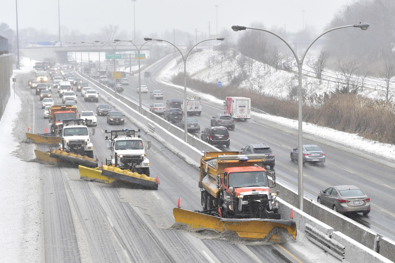 <p>A line of snow plwos clears the gardiner Expressway in Toronto on Feb.12, 2019 after a winter storm hit the region. THE CANADIAN PRESS/Frank Gunn </p>