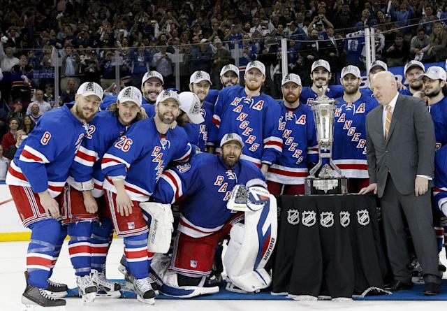 The New York Rangers pose for a photo with the Prince of Wales Trophy after beating the Montreal Canadiens 1-0 in Game 6 of the NHL hockey Stanley Cup playoffs Eastern Conference finals, Thursday, May 29, 2014, in New York. (AP Photo/Kathy Willens)