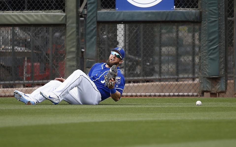 Kansas City Royals left fielder Alex Gordon is unable to come up with a ball hit by Milwaukee Brewers' Domingo Santana during the fourth inning of a spring training baseball game Wednesday, March 7, 2018, in Surprise, Ariz. (AP Photo/Ross D. Franklin)