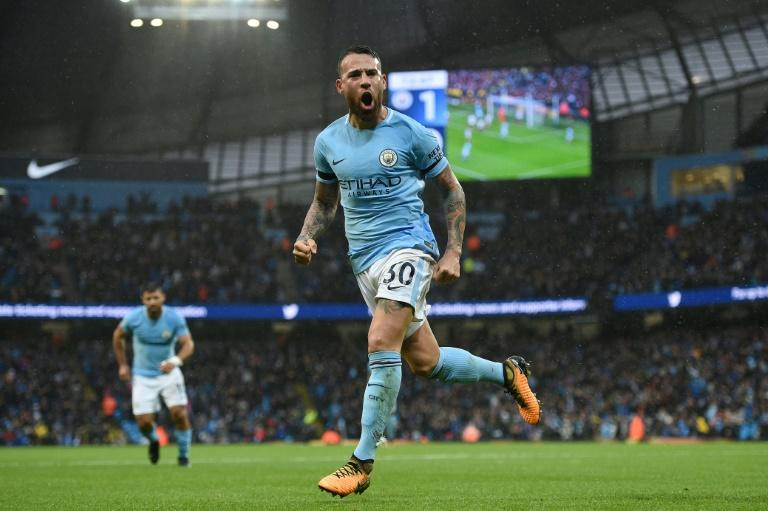 Manchester City defender Nicolas Otamendi celebrates scoring his team's second goal during their match against Burnley at the Etihad Stadium in Manchester, north west England, on October 21, 2017