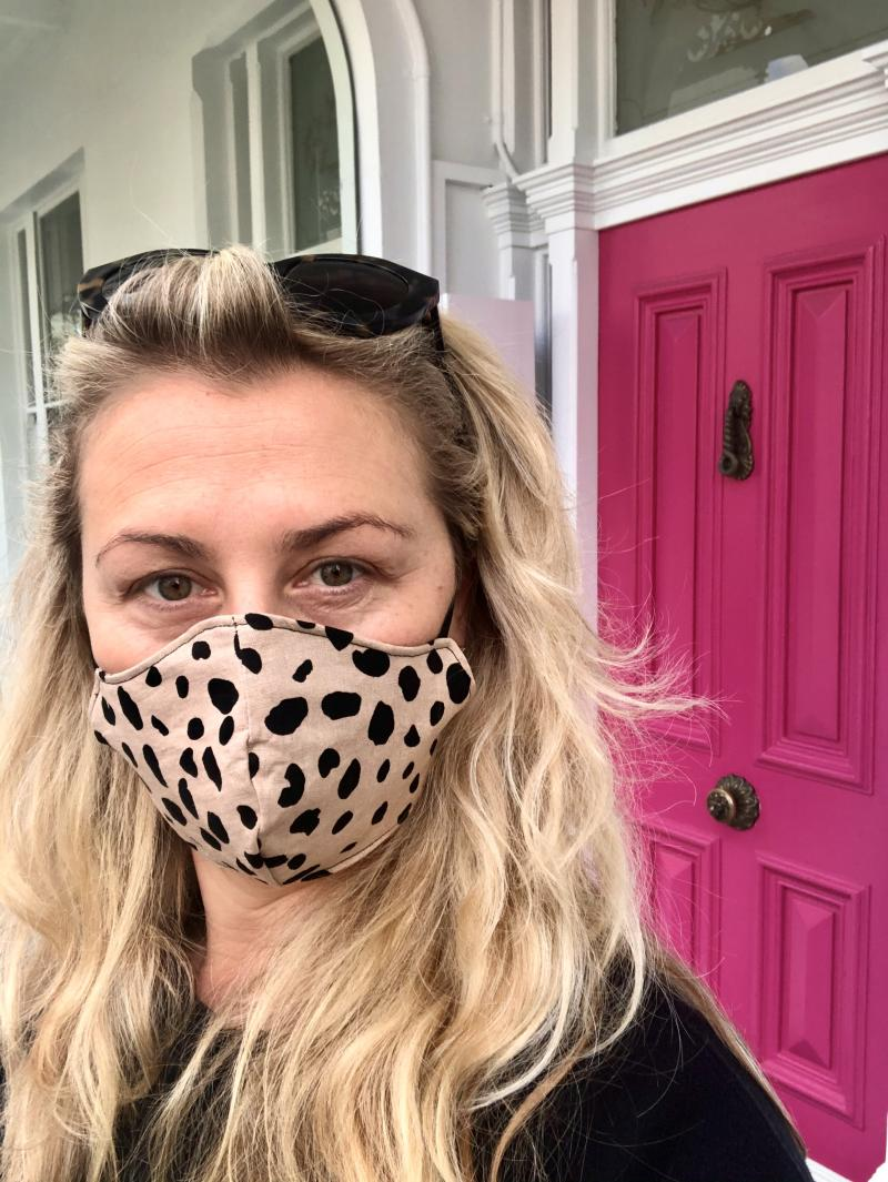 Dominica Graham is seen wearing a mask in a selfie taken outside of her oncologist's office after learning of her cancer diagnosis.